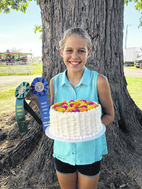 Roni Poling, 12, daughter of Dan and Gina Poling, of Russia, received outstanding of the day and state fair qualifier with her entry in cake decorating. She is a member of the Russia Fashionettes 4-H Club.