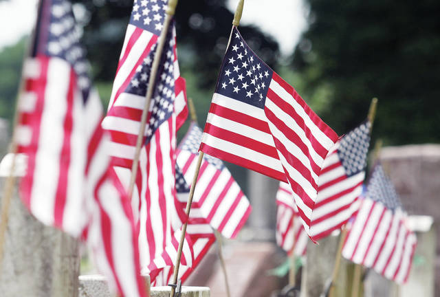In honor of the Fourth of July, flags fly on the graves of Civil War soldiers at Graceland Cemetery Monday, July 2. Americans will pause on July 4 to remember the birthdate of America's freedom and those who have fought to defend our country from 1776 until today.