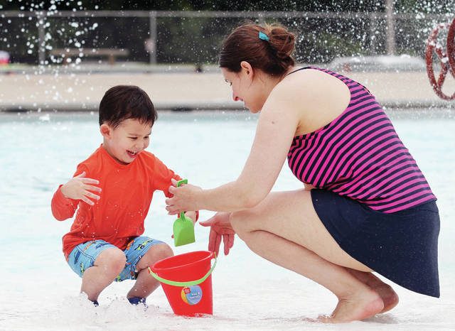 Colton Tran-Lam, left, 4, plays with his mom Katie Tran-Lam, both of Oakton, Va., at the City of Sidney Municipal Pool Monday, July 2. Tran-Lam is a Sidney High School graduate and was in town to celebrate her grandpa, Darrell Henson's 86th birthday which lands on the Fourth of July. Colton is also the son of Van Tran-Lam.