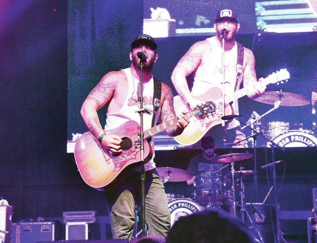 Josh Phillips performs on the Saloon Stage at Country Concert Thursday, July 5.