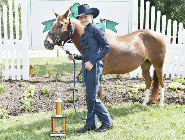 Sophia Brewer, 10, of Anna, daughter of Ryan and Nykole Brewer, a member of Horse and Rider 4-H Club, won champion trail in hand at the fair.
