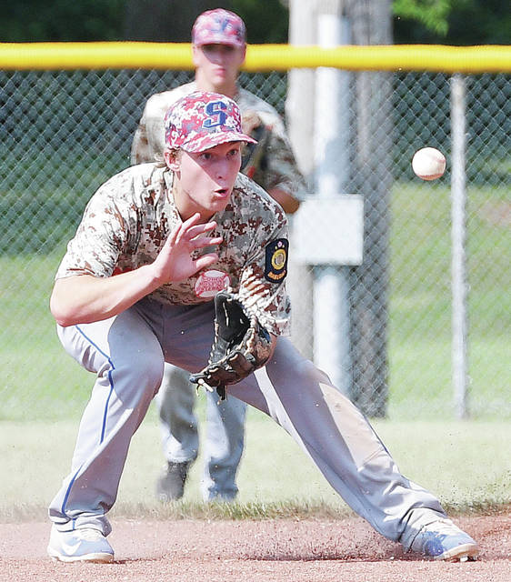 Sidney Post 217's Dion Puthoff fields a hit during a Region 2 tournament game on Sunday at Custenborder Field.