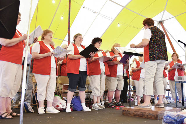 The Sidney Senior Center Singers perform during Senior Citizens Day activities under the free entertainment tent at the fair Tuesday, July 24.