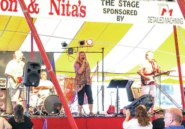The Flashback band performs in the free entertainment tent Tuesday, July 24.