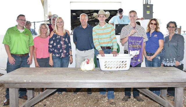 Cade Allison, 16, of Maplewood, son of Dean and Cari Allison, member of Fairlawn FFA, sells his grand champion pen of broilers at the fair Friday, July 27.