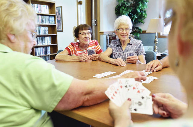 Playing a game of 7's at the Anna Community Branch Library Tuesday, July 31, are, left to right, LaDonna Locker, Janet Hoying and Eileen Boyer, all of Anna. Also playing are (not pictured) Dick Eshelman, of Anna, and Mary Barlage, of Wapakoneta. The group gets together every Tuesday at the Anna library to play different card games. New players are welcome to join at anytime.