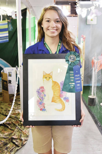 Samantha Gaerke, 18, of Russia, daughter of Jason and Judie Gaerke, a member of Russia Livestock, won outstanding of the day, senior painting watercolor at the fair.
