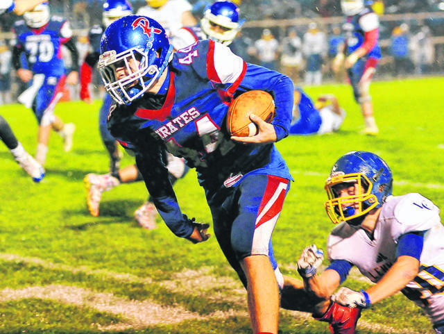 Riverside's Gaven Anderson runs the ball as Lehman's Braiden Sherman tries to tackle during a Northwest Central Conference game on Oct. 27, 2017 in DeGraff. Anderson ran for 1,325 yards on 97 carries and scored 16 touchdowns last season.