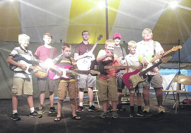 Sunday evening at the Shelby County Fair an audience was entertained by the guitar kids. Tim (Timmy G) Musser, along with this group of hard working and dedicated guitar students performed under the Big Top. Students who performed were, left to right, Trey Sparks, Noah Barr, Johnathan Martin, David Ostendorf, Josh Boyd, Garrett Etzkorn, Brady Sparks and Timmy G.