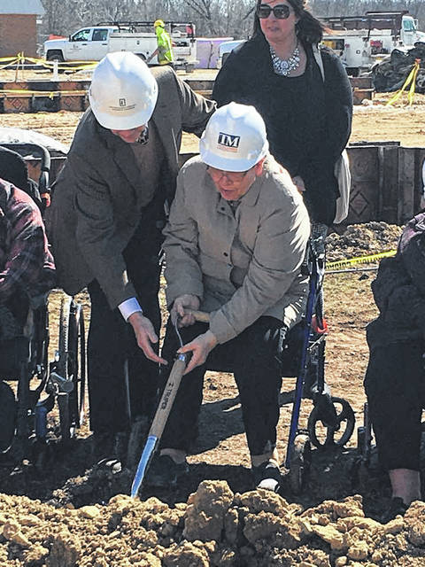 Resident Council Secretary Deborah Schaffner and Architect Dan Freytag participate in the groundbreaking ceremony for Fair Haven's new addition.