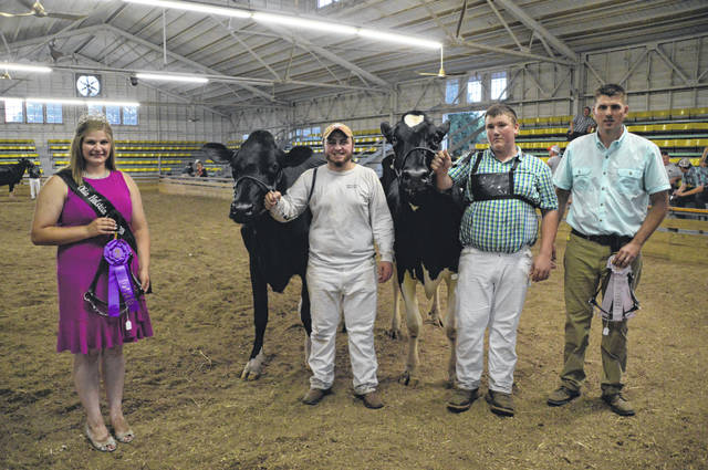 Shown are, left to right, Allison McCumons, Ohio Holstein Queen; Logan Topp, Grand Champion Junior Show; Aaron Carle, Reserve Champion Junior Show; Judge Rudy Kiko