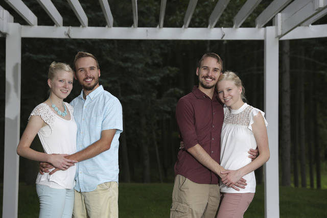 From left, Krissie Bevier and fianc, Zack Lewan and Nicholas Lewan and fianc, Kassie Bevier, pose for a photo, Sunday, July 29, 2018, in Grass Lake. Identical twins Krissie and Kassie Bevier are marrying identical twins, Zack and Nicholas Lewan. (Nikos Frazier /Jackson Citizen Patriot via AP)