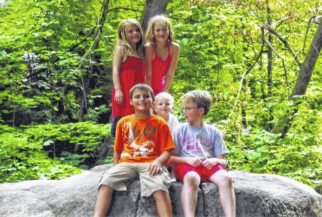 "Grandchildren of Yelonda and Larry Fultz, of Botkins, pose in 2011 for the first ""cousins photo"" atop Big Rock in Sidney's Tawawa Park. They are, from left, front row, Hunter Fultz, then 9, Bryce Fultz, 4, and Gareth Fultz. Back row, Camille Fultz and Teagen Fultz. Hunter and Teagan are children of Jodi and Choice Fultz, of New Knoxville. Bryce, Gareth and Camille are children of Theresa and Chance Fultz, of Miamisburg."
