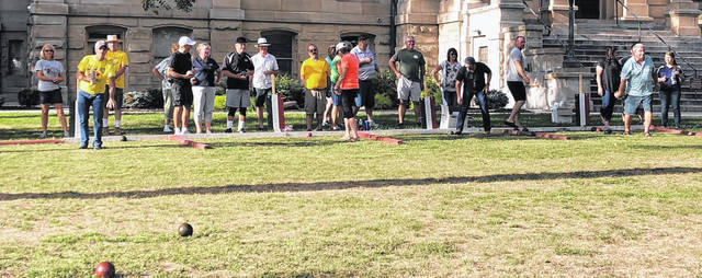 Teams in the Sidney Bocce League compete recently on the courtsquare in downtown Sidney.