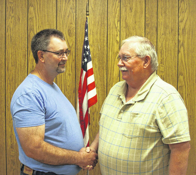 Port Jefferson Mayor Steve Butterfield welcomes Bob Bollinger to the village council during Monday night's meeting.