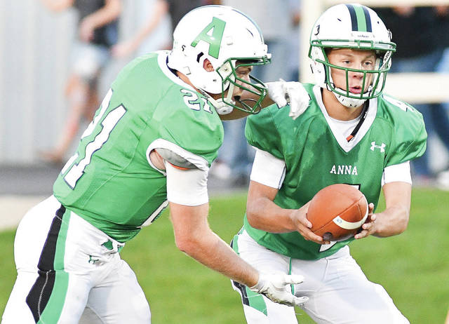 Anna junior quarterback Bart Bixler, right, makes a handoff to graduated running back Aidan Endsley in the first quarter of a Midwest Athletic Conference game against New Bremen on Sept. 15, 2017. Bixler played in extensively in three games last year when graduated QB Travis Meyer was injured.