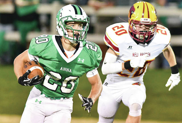 Anna running back Riley Huelskamp, left, runs ahead of New Bremen's Caleb Alig during a Midwest Athletic Conference game on Sept. 15, 2017 in Anna. Huelskamp led the Rockets ground attack as a sophomore with 944 yards and 12 touchdowns.