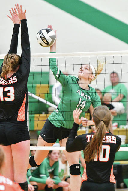Anna junior middle hitter Emma Meyer spikes during a match against Jackson Center in Anna on Aug. 31, 2017. Meyer, who led the Rockets in kills and blocks, is one of five returning starters.