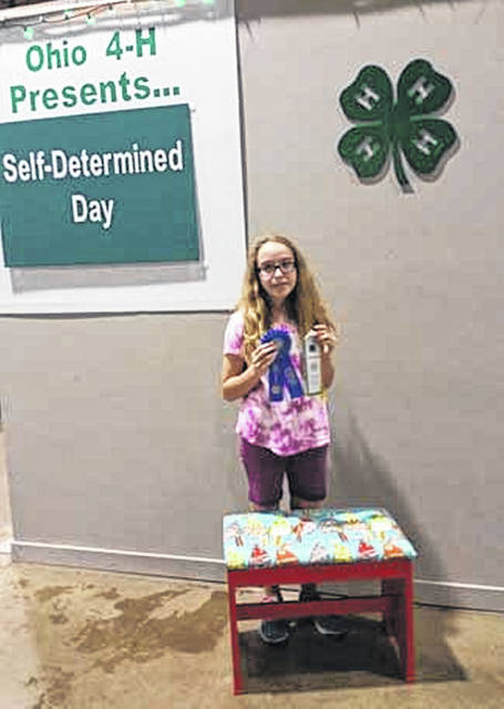 Asa DeMange, 13, daughter of Stacy and Ken Demange, of Versailles, earned a superior ribbon for her Self Determined project, a bench she refinished, and the clock trophy on Companion Animal day for a cavy project at the 2018 Ohio State Fair. She is a member of Versailles Busy Beavers and Canine Capers 4-H clubs.