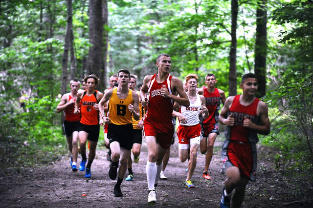 Houston;s Ethan Knouff, center, runs in a pack in the Division II-III small school meet during the Bob Schul Invitational on Saturday in West Milton. Knouff finished 24th.