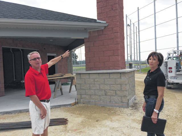 Craig Drees, park committee president, left, and Diane Meyer, committee vice president, point to work being done on the new concessions stand.