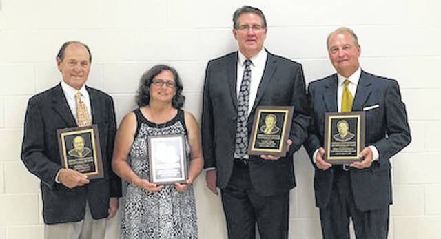 Inducted into the Lehman Catholic High School Hall of Fame were, left to right, Benjamin P. Scott Sr., Jill Burden, daughter of the late Lester and Marilyn Kloeker, Thomas J. Frantz, and William R. Zimmerman Sr.