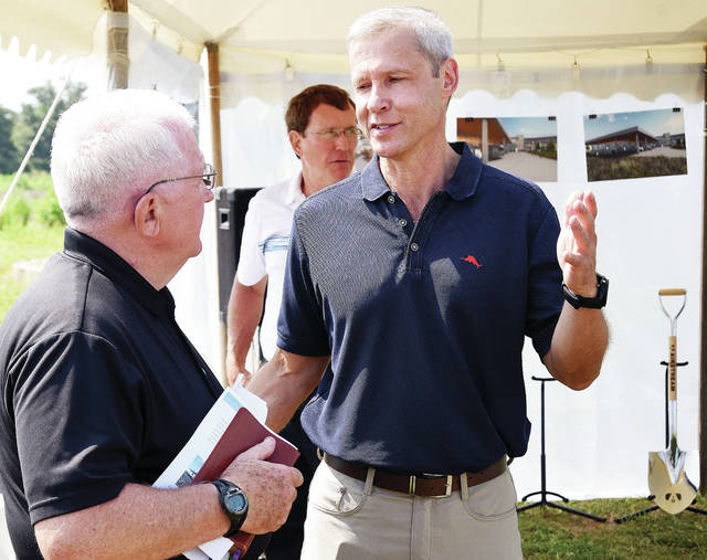 Bob Wheeler, president and CEO of Airstream, right, chats with Terry Coleman, former Airstream associate, during an Airstream groundbreaking ceremony, Friday, Aug. 3, in Jackson Center.