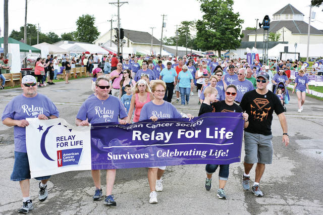 Cancer survivors take the first lap during the Shelby County Relay for Life at the Shelby County Fairgrounds Friday, Aug. 3.