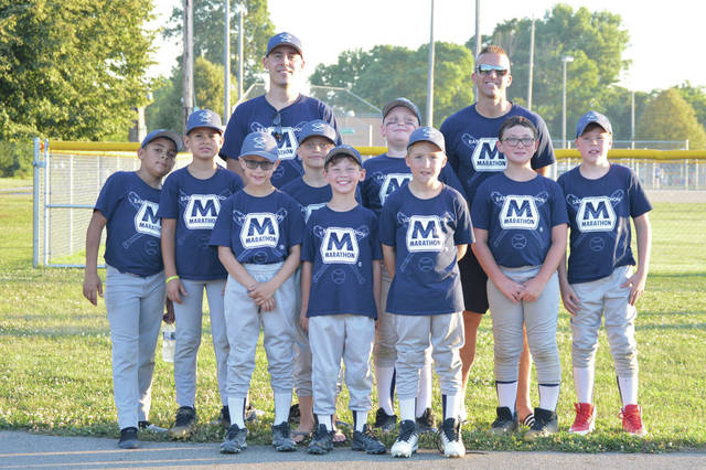 D-ball team Marathon won the Sidney amateur baseball championship recently at Custenberder Field. Their coaches are Andy Steenrod, back, left, and Dallas Davis.