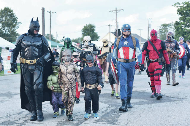 Members of the group Hero Strong walk with kids during the 2018 Relay for Life Friday, Aug. 3.