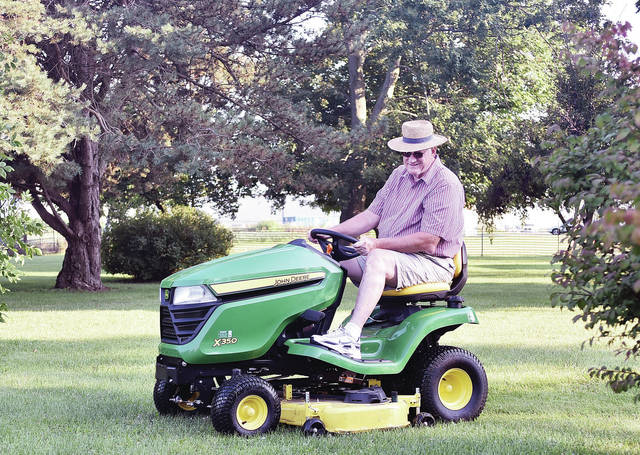 Wayne York, of Jackson Center, mows his lawn on his new lawn mower Tuesday, Aug. 14.