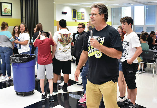 Sidney High School Assistant Principal John Willoughby helps SHS freshmen learn the lunchtime routine during orientation Thursday, Aug. 16. This is the first year the high school has held an all-day freshman orientation for the students on the first day of school. Students in grades 10-12 will have their first day of classes Friday, Aug. 17.