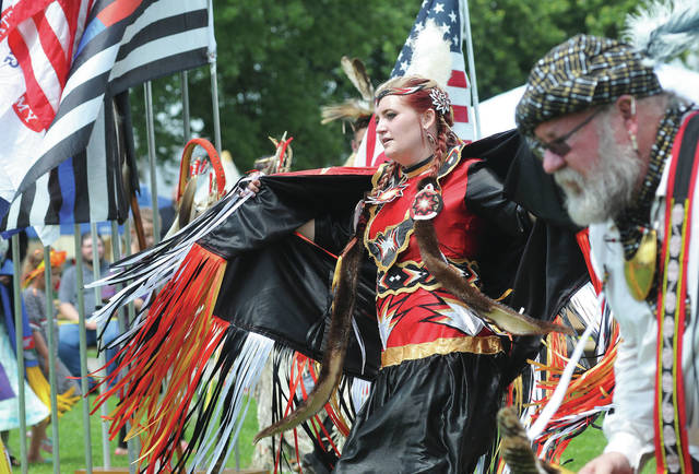 Head Lady Sawyer Hacker, of Middletown, dances during the seventh annual Honoring Our Veterans and First Responders Pow Wow Saturday, Aug. 18 at the Shelby County Fairgrounds.