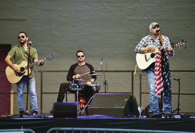 Eric Sowers Band performs behind the Historic Sidney Theatre Saturday, Aug. 25. The headliner, Commander Cody, cancelled due to sudden health reasons. The performance was the last of the Backstage Block Party events this year.