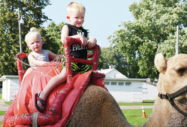 Kohen Clark, 4, right, and Laken Clark, 2, both of Anna, ride on a camal at the Zerbini Circus Monday, Aug. 27. They are the children of Zach and Krista Clark.