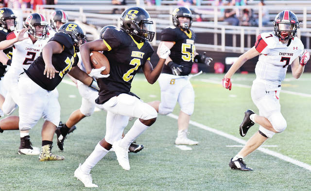 """Sidney freshman Quamir """"Philly"""" Brown runs during a nonconference game against Bellefontaine on Thursday at Sidney Memorial Stadium."""