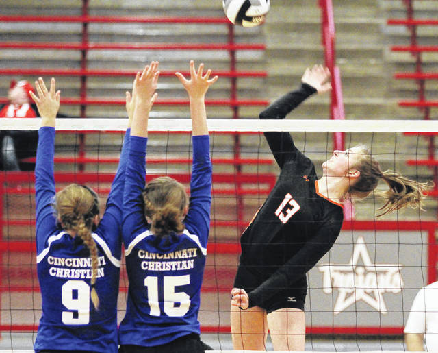 Jackson Center's Raquel Kessler, right, spikes towards Cincinnati Christian players during a Division IV district final match on Oct. 28, 2017 in Troy. Kessler is the reigning Shelby County Athletic League player of the year.