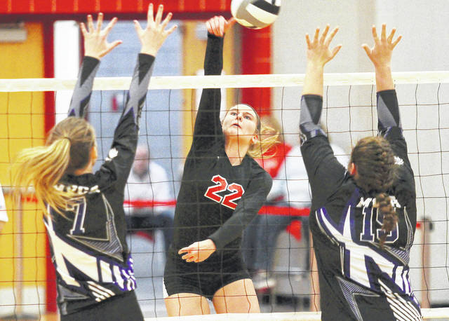 Fort Loramie's Marissa Meiring spikes towards two Miami Valley Christian Academy players during a district final match on Oct. 28, 2017 at the Trojan Activities Center in Troy. Meiring is one of four returning starters for the Redskins, who have their top three leaders in kills from last season back.