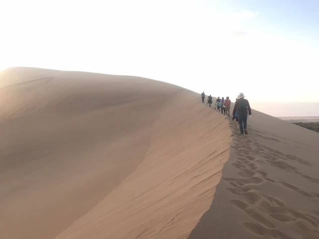 The mission group with whom Jessica Witer, of Anna, spent the summer, hikes along a sand dune near Walvis Bay, Namibia, in July.