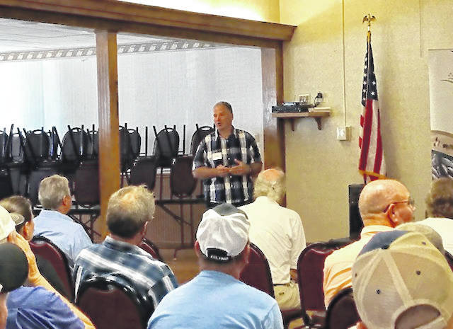 Dairy Farmers of Ontario Vice Chairman Murray Sherk speaks at the Maria Stein American Legion Auxiliary Post 571, on Aug. 28, to share his perspective on pros and cons of the Canadian dairy supply management system.