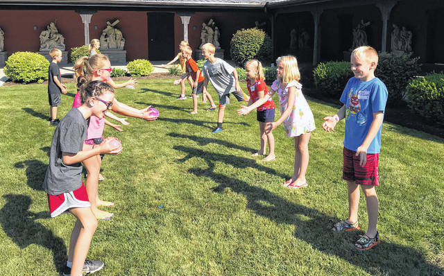 Children learn about St. Stephan's martyrdom during a water balloon toss.