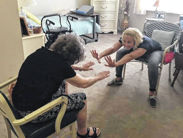 Gina Boerger, physical therapist, works with a home health patient.