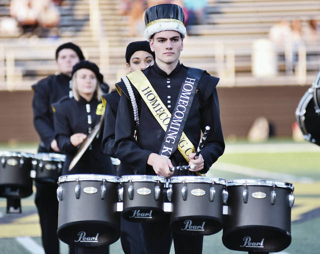 Sidney Homecoming king Colin Freistuhler performs with the Sidney High School marching band before Sidney's Greater Western Ohio Conference American North Division game against Piqua on Friday at Sidney Memorial Stadium.
