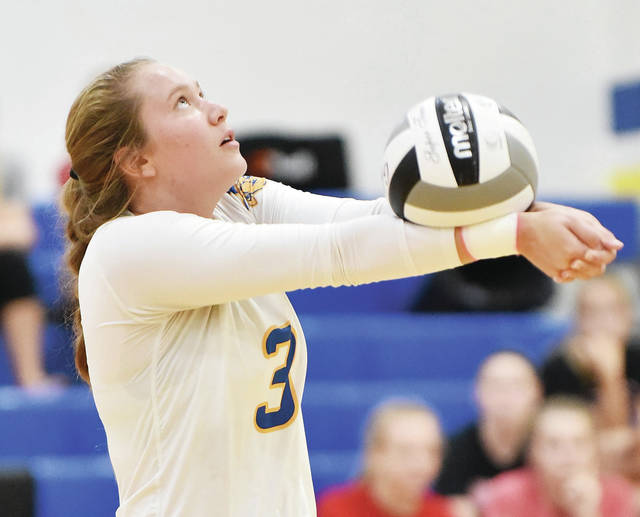 Russia's Jenna Cordonnier gets under the ball against Fort Loramie at Russia Thursday.