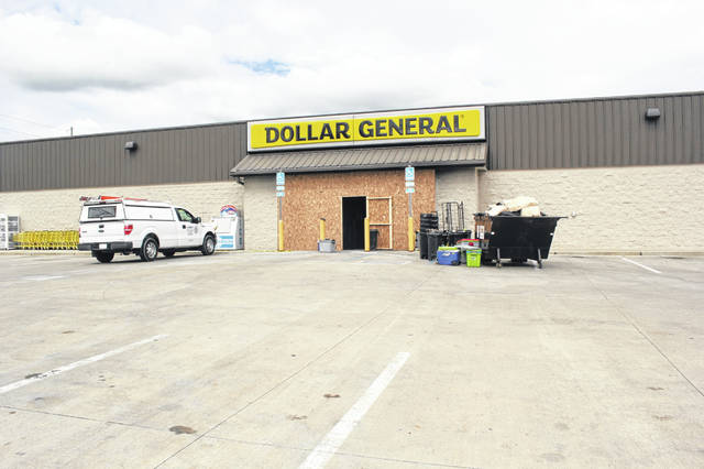 The front entrance at Dollar General on Russell Road in Sidney is boarded up as work begins repairing the fire and smoke damage which happened Sunday afternoon.