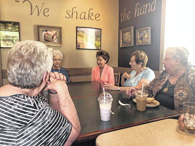 Janet Garrett, center, of Oberlin, a candidate for Ohio's 4th District seat in Congress, talks with the Shelby County Democrat Women recently in the High Grounds coffee shop in Sidney.