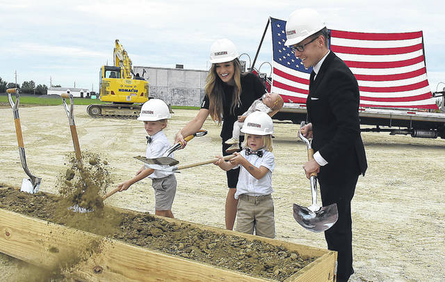 Nick Kennedy, far right, breaks ground for his new $4 million, 55,000 sq. ft. Flex Arm facility Monday in Wapakoneta with his wife, Ashley and three children, Weston, 6, Warren, 4, and Vanna, three months.