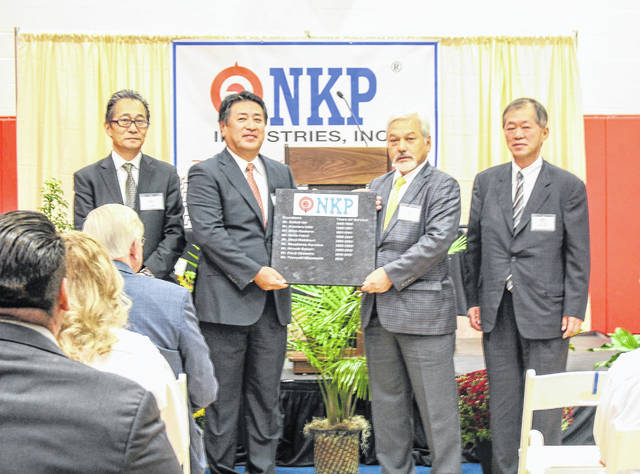 A plaque honoring all the presidents of NKP was unveiled Tuesday. Holding the plaque are four men who served as president. They are Kenji Okamoto, left to right, Yasayuki Mizumachi, Masakatsu Kuroiwa and Hiroshi Sakairi.