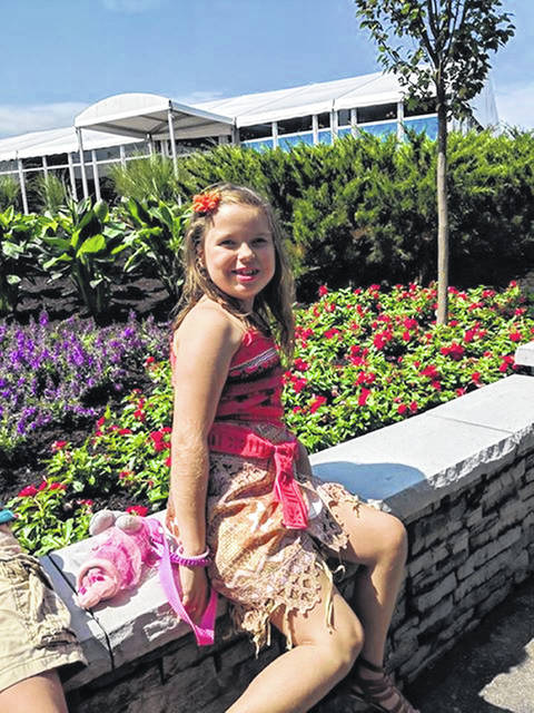"Rozlyn ""Roz"" Abbott, 8, daughter of Anne and Matthew Abbott, of Sidney, will be throwing out the first pitch of the baseball game between the Reds and San Diego Padres Friday night."