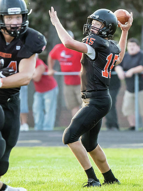 Minster junior quarterback Jacob Niemeyer throws during a nonconference game against Covington on Friday at Memorial Stadium. Niemeyer threw for 266 yards and two touchdowns.